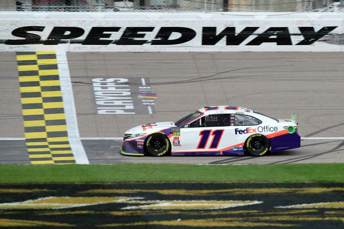 Denny Hamlin (11) crosses the finish line to win a NASCAR Cup Series auto race at Kansas Speedway in Kansas City, Kan., Sunday, Oct. 20, 2019. (AP Photo/Orlin Wagner)