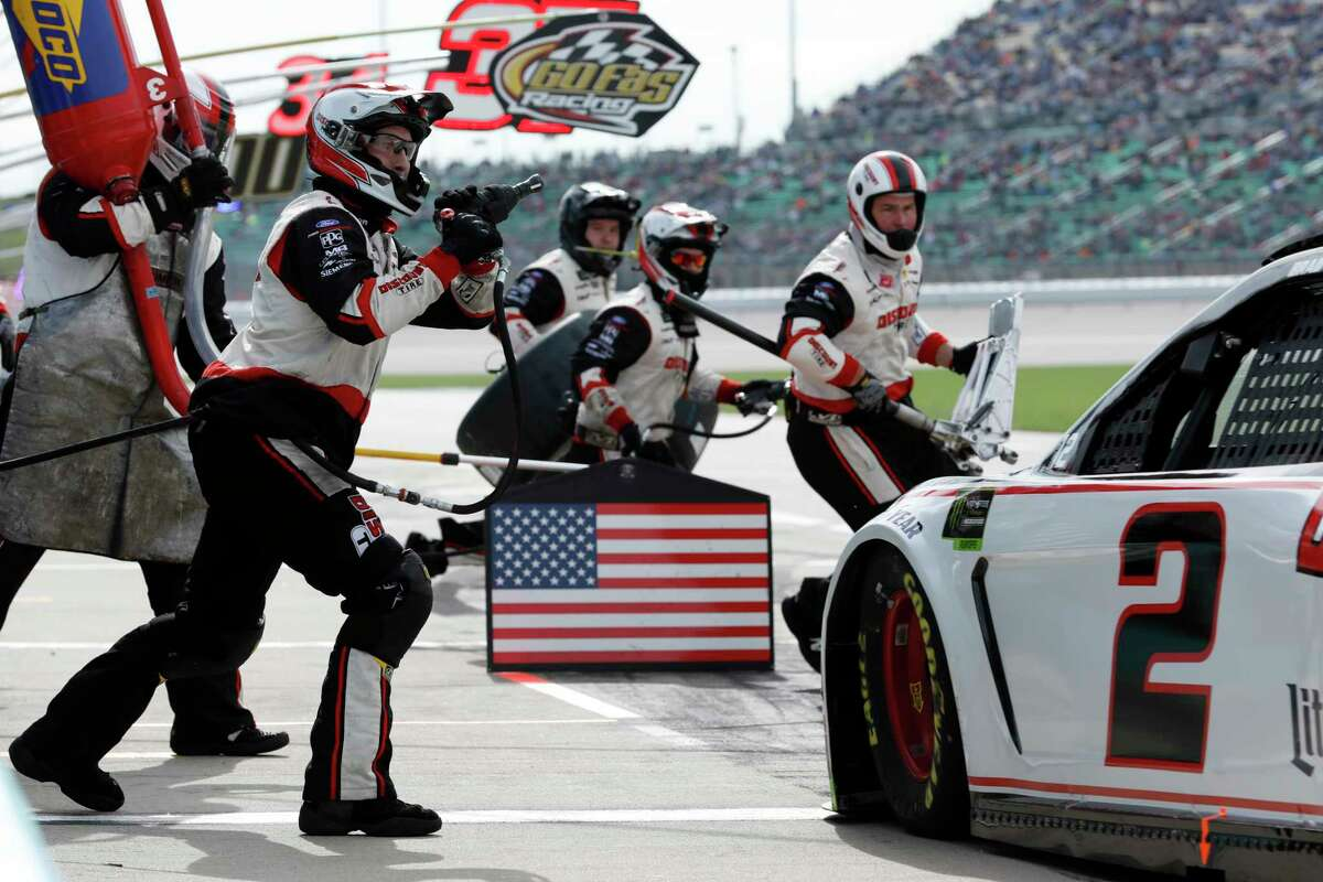 Brad Keselowski (2) pits during a NASCAR Cup Series auto race at Kansas Speedway in Kansas City, Kan., Sunday, Oct. 20, 2019. (AP Photo/Colin E. Braley)