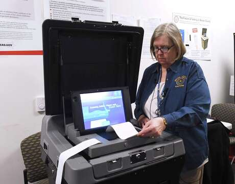 Bexar County Elections Administrator Jacque Callanen demonstrates a new voting machine.