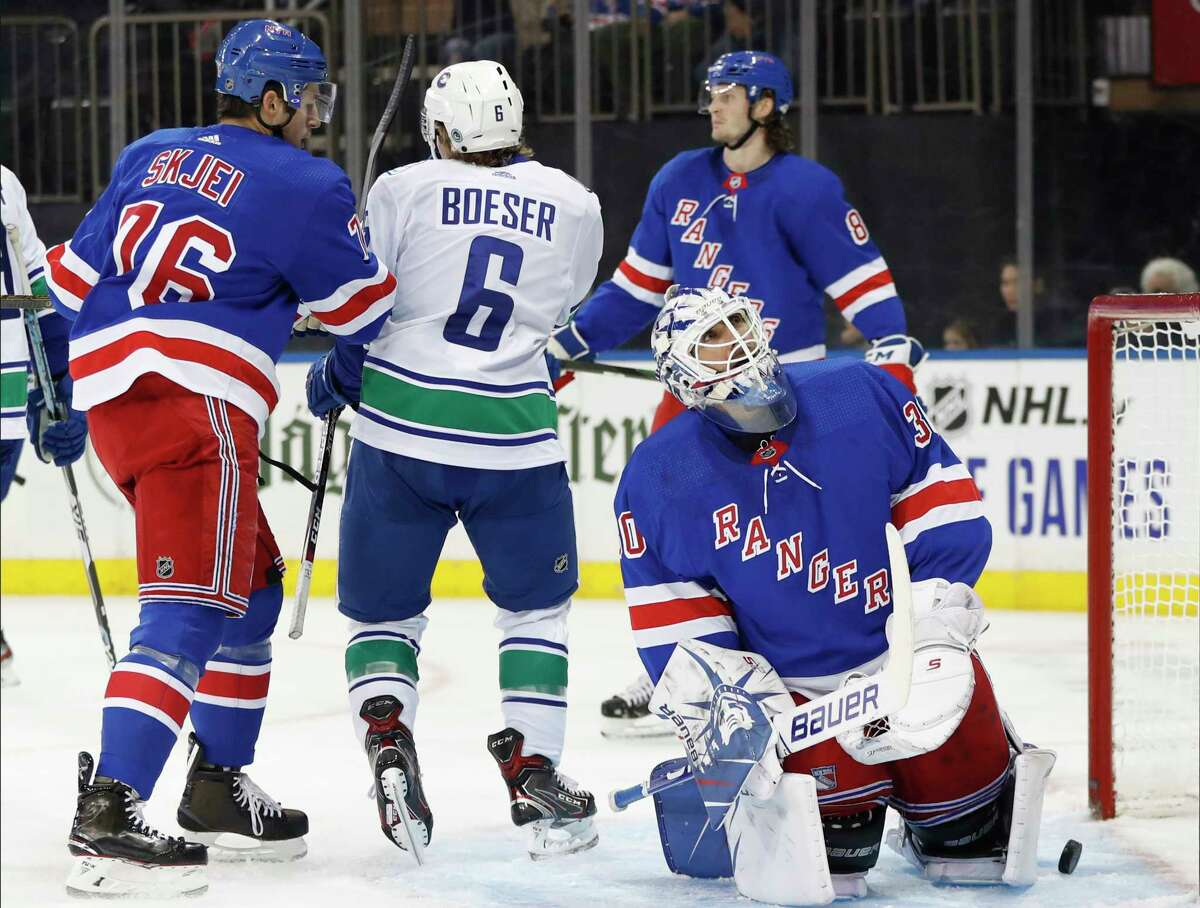 New York Rangers goaltender Henrik Lundqvist (30) of Sweden watches a video replay of a goal by Vancouver Canucks center Bo Horvat (not shown) in the first period of a NHL hockey game, Sunday, Oct. 20, 2019, in New York. (AP Photo/Kathy Willens)