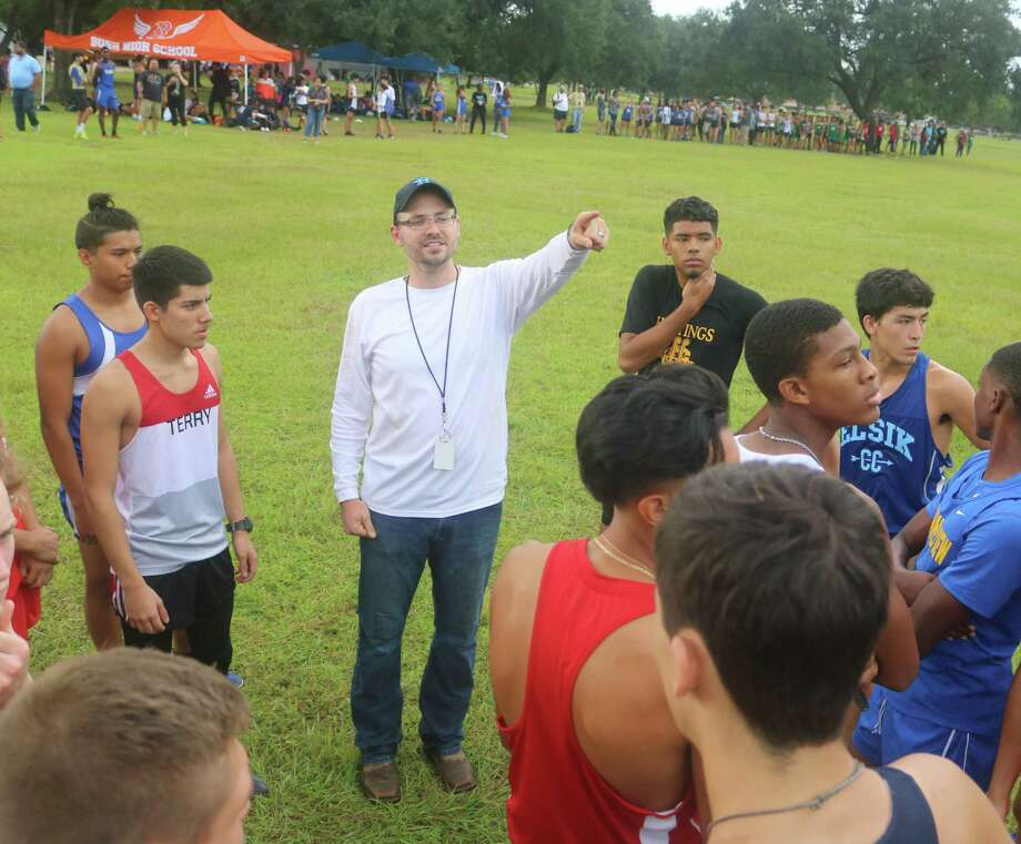 Sam Rayburn cross country coach Brandon Coslor, shown giving pre-race instructions at the Rayburn Invitational in 2018, defied the odds and got his Texans to earn back-to-back Region III berths. Photo: Robert Avery