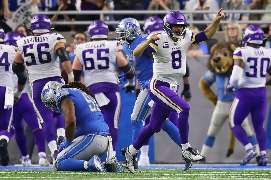 Vikings quarterback Kirk Cousins (8) celebrates in the fourth quarter after Dalvin Cook's 4-yard touchdown run with 1:55 left salted away Minnesota's win over Detroit. Photo: Gregory Shamus / Getty Images