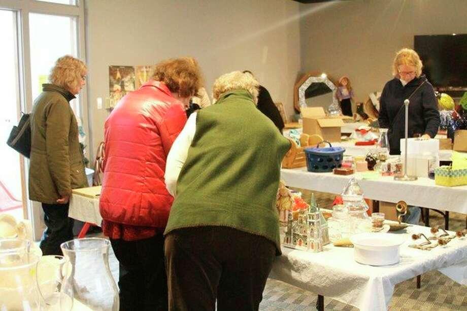 "Local residents shop ""attic treasures"" at the annual UMW Manistee Marketplace on Saturday. (Ashlyn Korienek/News Advocate)"
