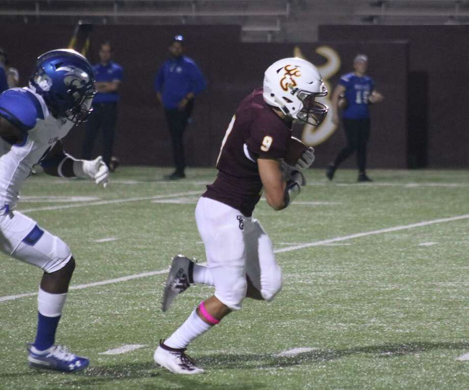 Marcus Moreno cradles Deer Park's first touchdown pass against C.E. King Friday night. With Moreno's help, the team's passing yardage remains in second place among the 21-6A teams. Photo: Robert Avery
