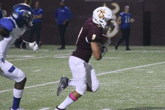 Marcus Moreno cradles Deer Park's first touchdown pass against C.E. King Friday night. With Moreno's help, the team's passing yardage remains in second place among the 21-6A teams.