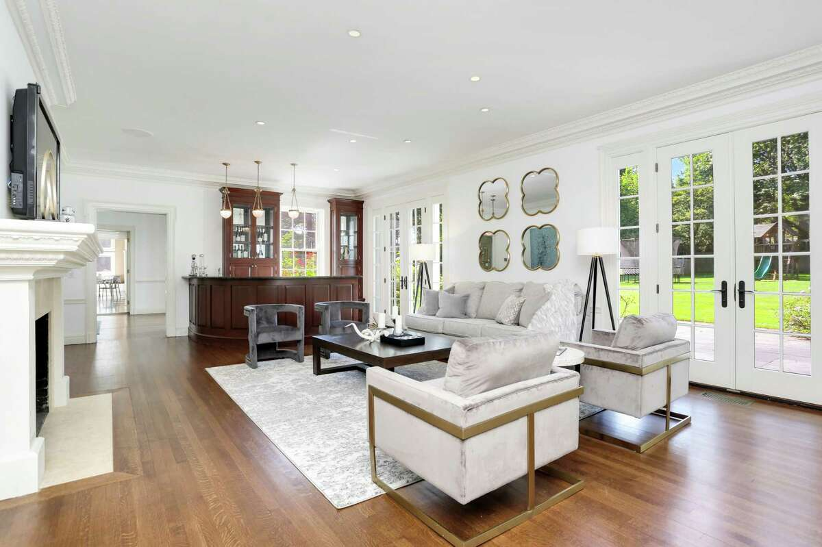 Listed for $6.995 million by Houlihan Lawrence, 11 Deer Park Court-a fully renovated 1936-era colonial-affords 7,937 square feet of living space, including a formal living room with a wet bar incorporated into the design of its formal living room.
