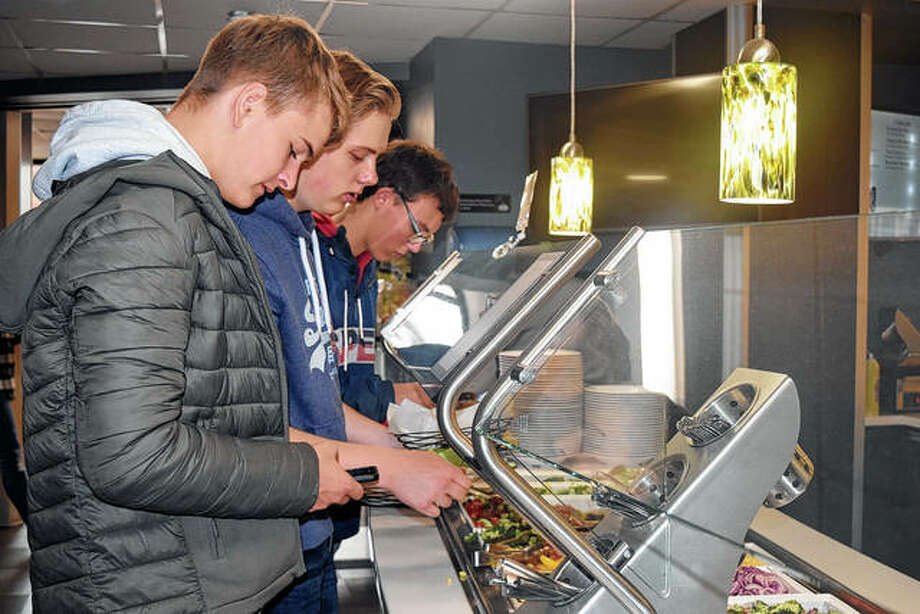 Students from Uelzen, Germany, take a lunch break from a tour of Illinois College campus Wednesday. Photo: Samantha McDaniel-Ogletree   Journal-Courier