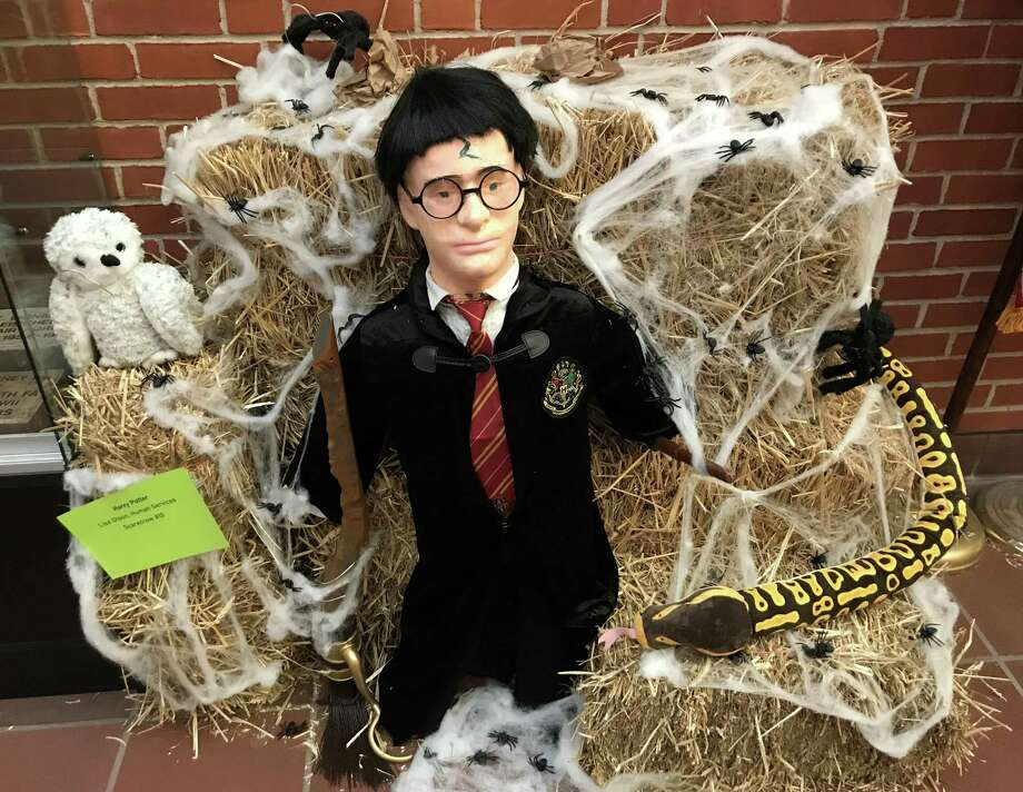 Cromwell will hold It's second annual scarecrow contest, the brainchild of Senior Center Director Amy Saada. Harry Potter was created by Lisa Olson, Human Services Department. Photo: Jeff Mill / Hearst Connecticut Media