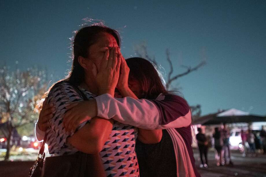 In this Sunday, Oct. 20, 2019 photo, Maribel Morales, a member of Primera Iglesia Dallas, is consoled by fellow church member Ashley Villalobos as she surveys severe damage to the church, which sits near Walnut Hill and Marsh Lane, after a tornado tore through North Dallas. Photo: Associated Press