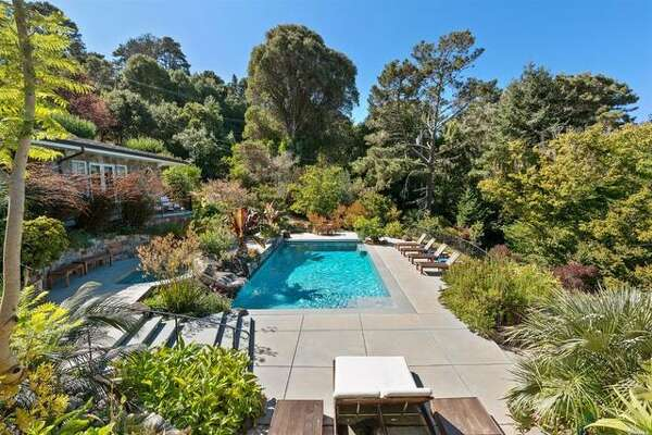 A gated estate at 3300 Paradise Dr. in Tiburon offers a well-constructed home in a verdant setting with wrap-around verandas, patios and balconies for taking in the stunning bay views.