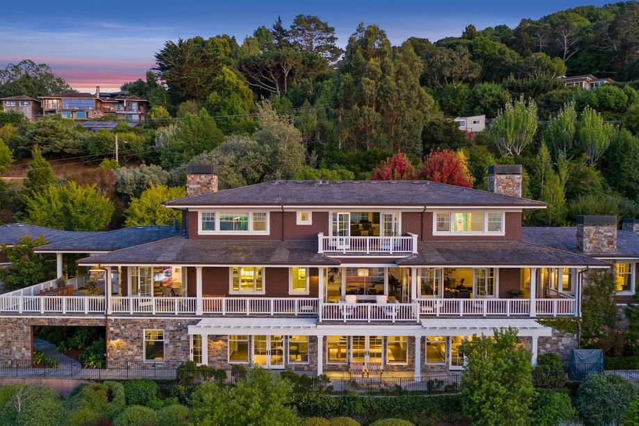 A gated estate at 3300 Paradise Dr. in Tiburon offers a well-constructed home in a verdant setting with wrap-around verandas, patios and balconies for taking in the stunning bay views. Photo: Open Homes Photography