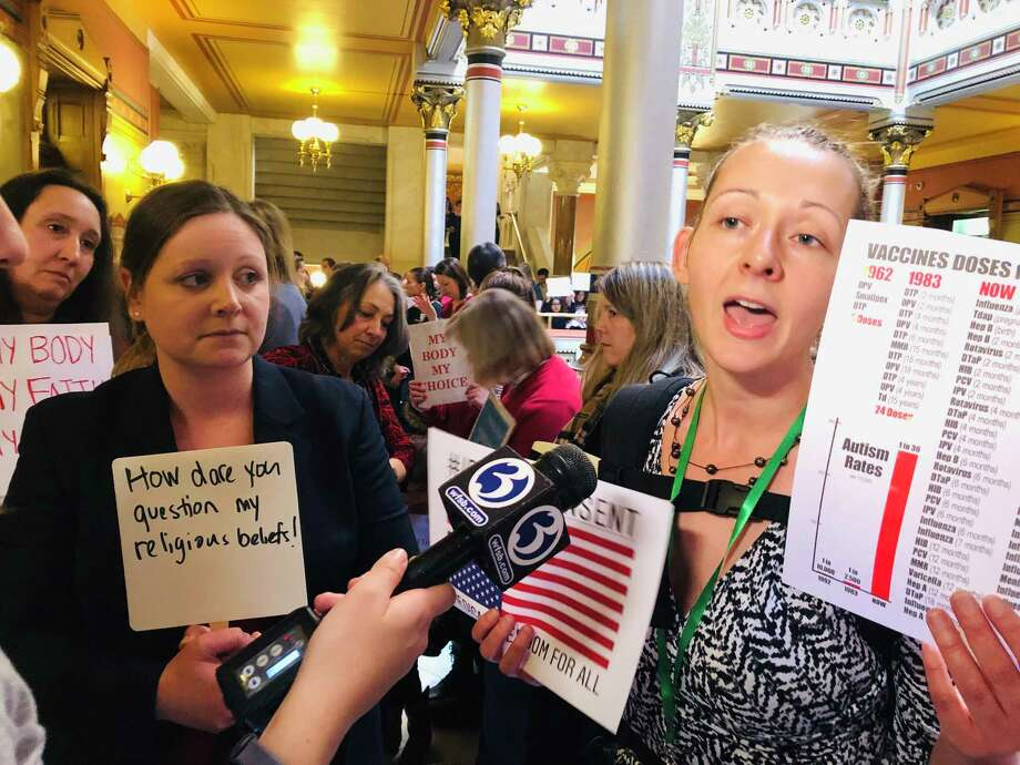 Activists decried a proposal to eliminate the religious exemptions on vaccines at the state Capitol last spring. Photo: CTMirror.org