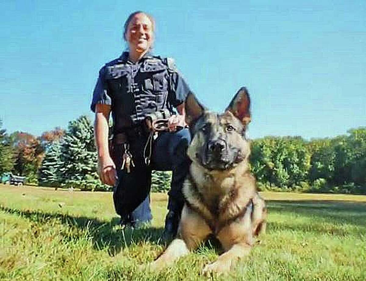 A Bridgeport K9 officer Marie Cetti and police dog Uno were injured Sunday after a vehicle struck their cruiser on Oct. 20, 2019.