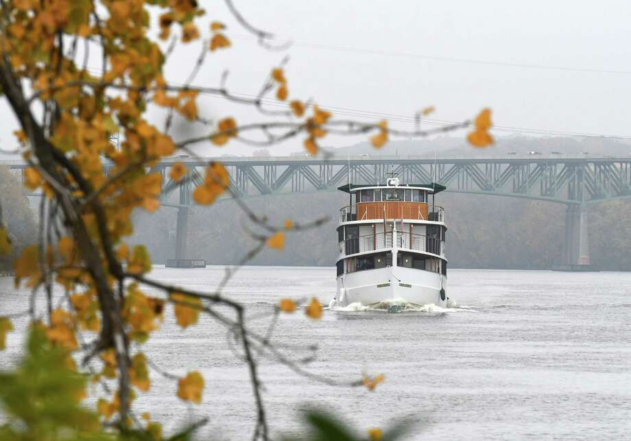 The Dutch Apple II tour boat heads south on the Hudson River toward the Livingston Avenue Bridge, taking guests on a charted Troy lock cruise, according to the company website, on Monday morning, Oct. 21, 2019, in Albany N.Y.  (Will Waldron/Times Union) Photo: Will Waldron, Albany Times Union