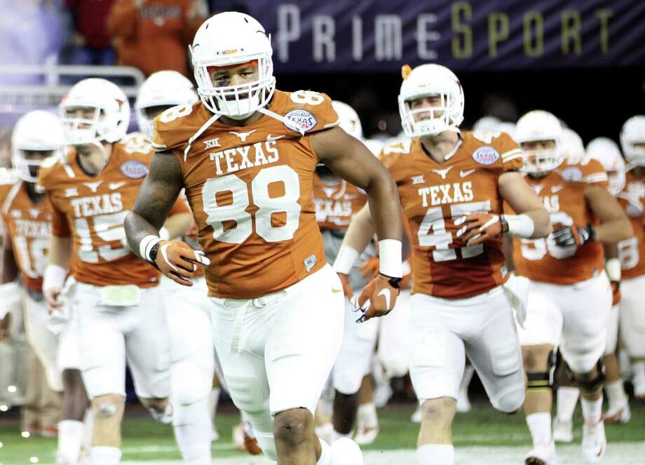 Cleveland's own Cedric Reed takes the field with the Longhorns for the Texas Bowl, Dec. 29, 2014. Photo: Albert Villegas / Albert Villegas