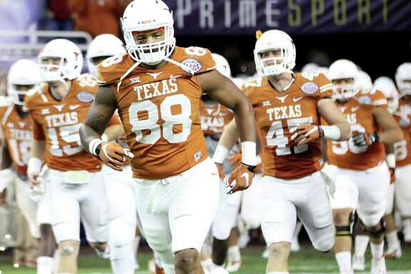 Cleveland's own Cedric Reed takes the field with the Longhorns for the Texas Bowl, Dec. 29, 2014.