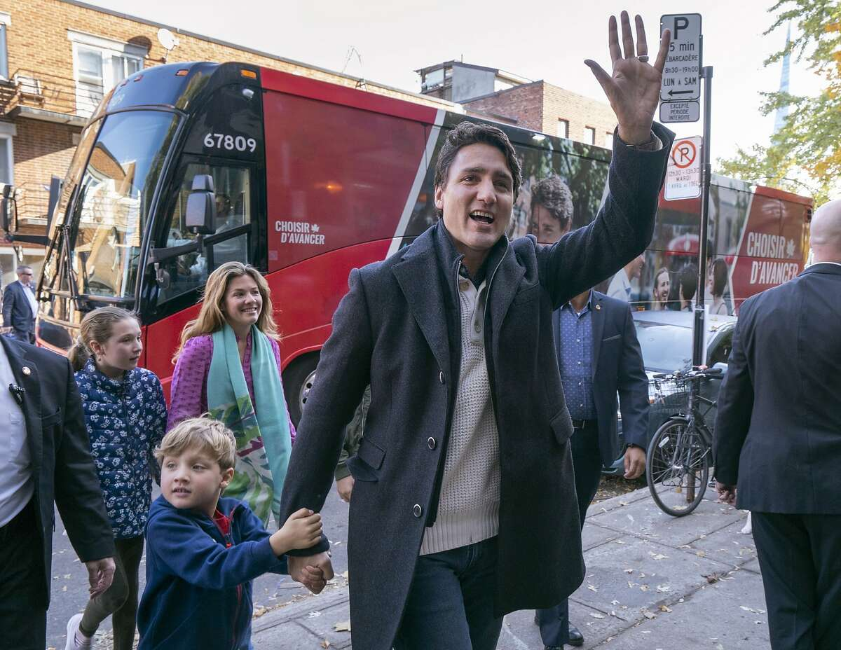 Canadian Prime Minister Liberal Leader Justin Trudeau arrives at the poling station with his son Hadrian, his wife Sophie and daughter Ella-Grace in Montreal, Monday, Oct. 21, 2019. (Paul Chiasson/The Canadian Press via AP)