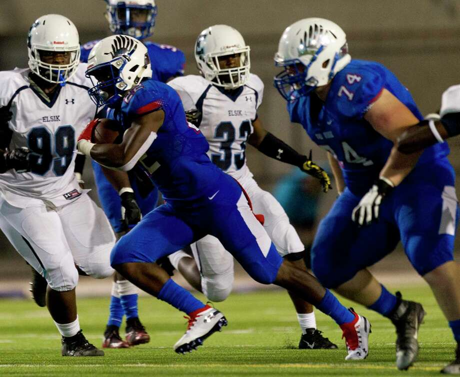 Oak Ridge running back Kywon Morgan (22) runs the ball as Elsik's Harrison Udeh (99) pursues during the third quarter of a non-district high school football game at Woodforest Bank Stadium, Friday, Sept. 6, 2019, in Shenandoah. Photo: Jason Fochtman, Houston Chronicle / Staff Photographer / Houston Chronicle