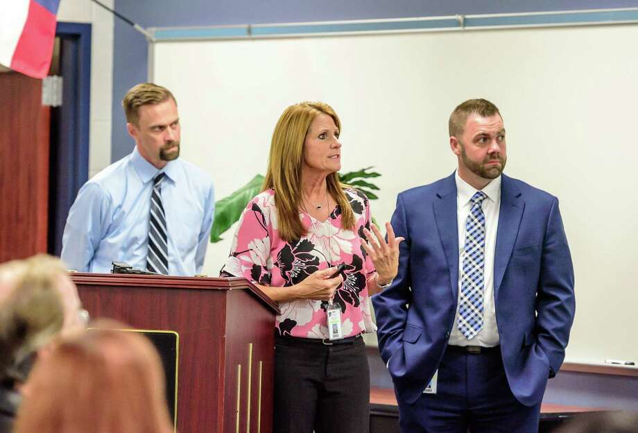 "Pearland ISD principals Kai Boussard of Turner high school, left, Kelly Holt Dawson High School and John Palombo of Pearland High school spoke about the vaping problem in their schools during a town hall meeting at Dawson in October. ""It's an uphill battle right now,"" Palombo said. Photo: Kim Christensen, Photographer / Kim Christensen / Copyright Kim Christensen"