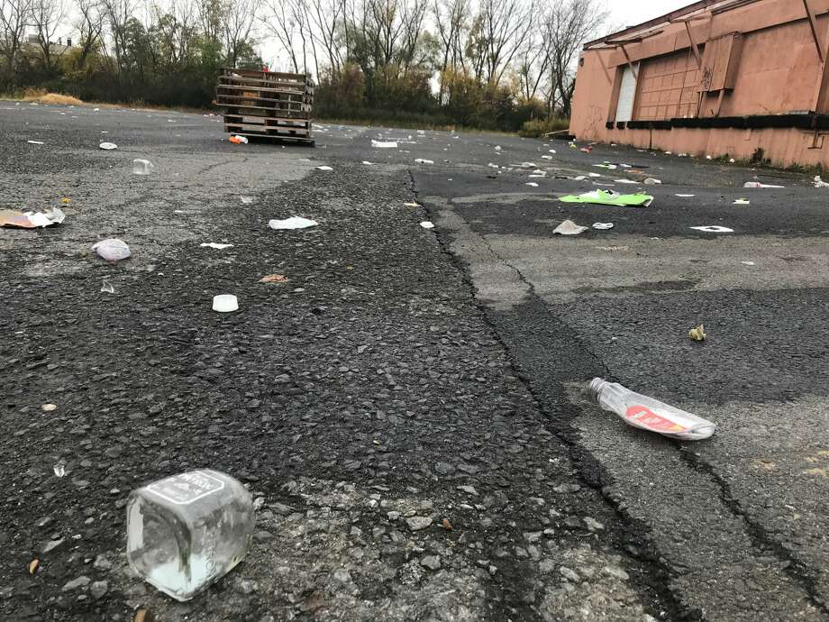 The aftermath from a massive party held in the parking lot of a warehouse at 21 Simmons Lane, Menands as seen Oct. 21, 2019. The clandestine party targeted UAlbany students celebrating on homecoming weekend. About 1,000 people attended on Oct. 19, 2019. The lot's owner said he was unaware of the party, and wants the organizers charged with trespassing. Photo: Lauren Stanforth/Times Union