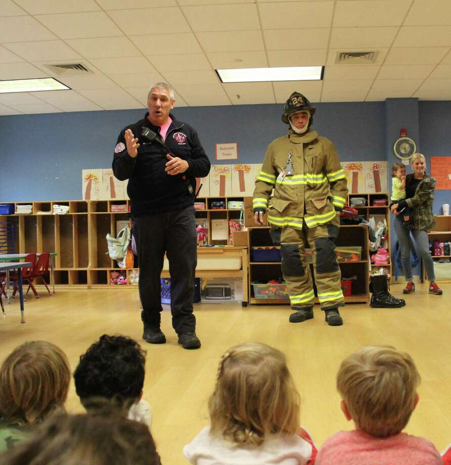 On Oct. 9, Firefighters Paul Wilson and Paul Devan visited New Canaan YMCA's Rainbow Station Preschool to teach kids about the importance of fire safety. Contributed photo Photo: Contributed Photo