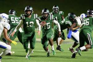 Julius Loughridge (15) of Mayde Creek carries the ball during the third quarter of a 6A Region III District 19 football game between the Taylor Mustangs and Mayde Creek Rams on Friday, October 18, 2019 at Rhodes Stadium, Katy, TX.