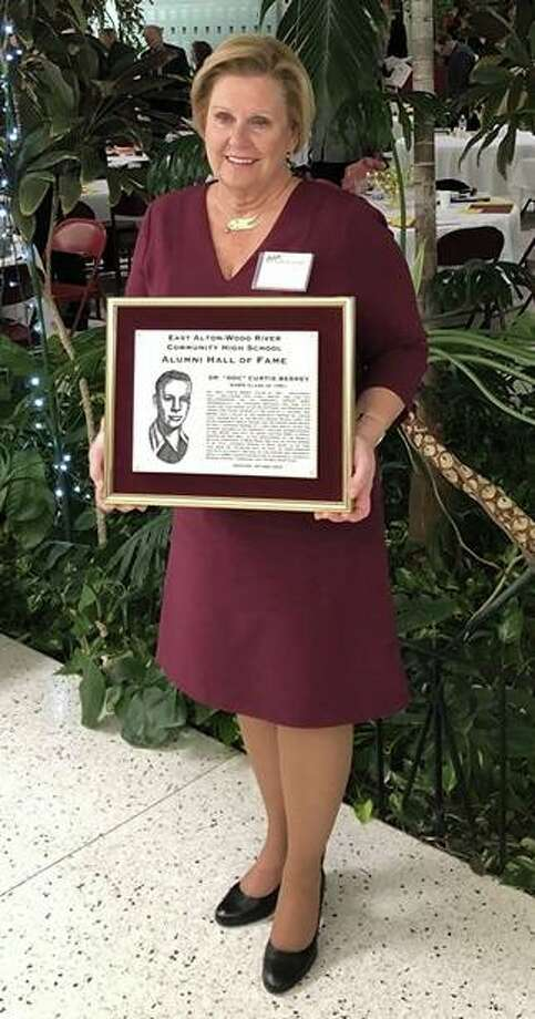 Glenda Berrey holds a plaque honoring her late husband, Dr. Curtis Berrey, during this year's East Alton Wood River Oilers Hall of Fame ceremony on Oct. 12.