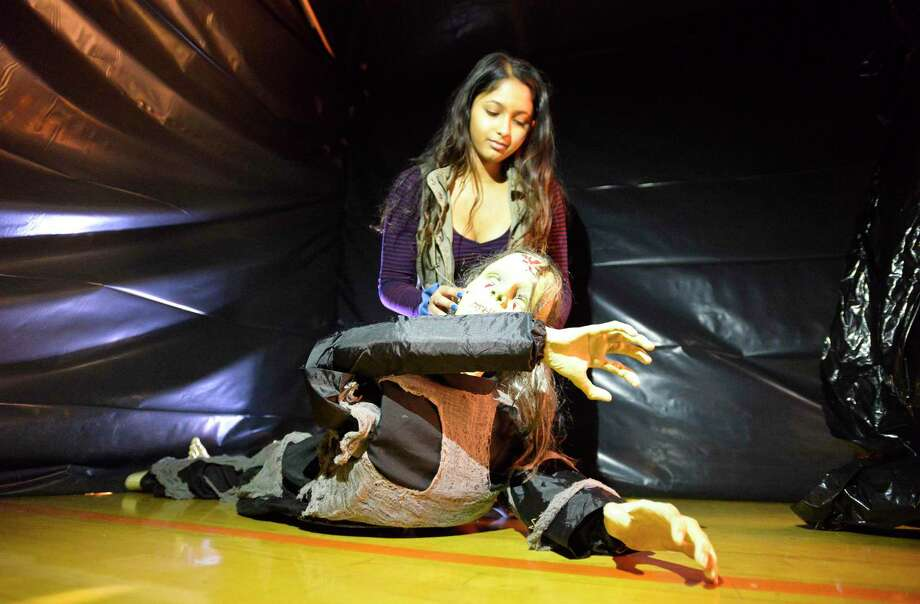 Geetha Weerakoon, a senior at Stamford High School, adjusts an animatronic Halloween figure that is part of the annual haunted scare house at the school in Stamford, Connecticut., Friday, Oct. 19, 2018. Stamford High School student council host the haunted attraction, which runs thru Saturday, Oct. 20, from 7 p.m. to 11 p.m. Funds from the event will go to support the senior class. Tickets are $10 for a single run or $15 for unlimited runs. Photo: Matthew Brown / Hearst Connecticut Media / Stamford Advocate