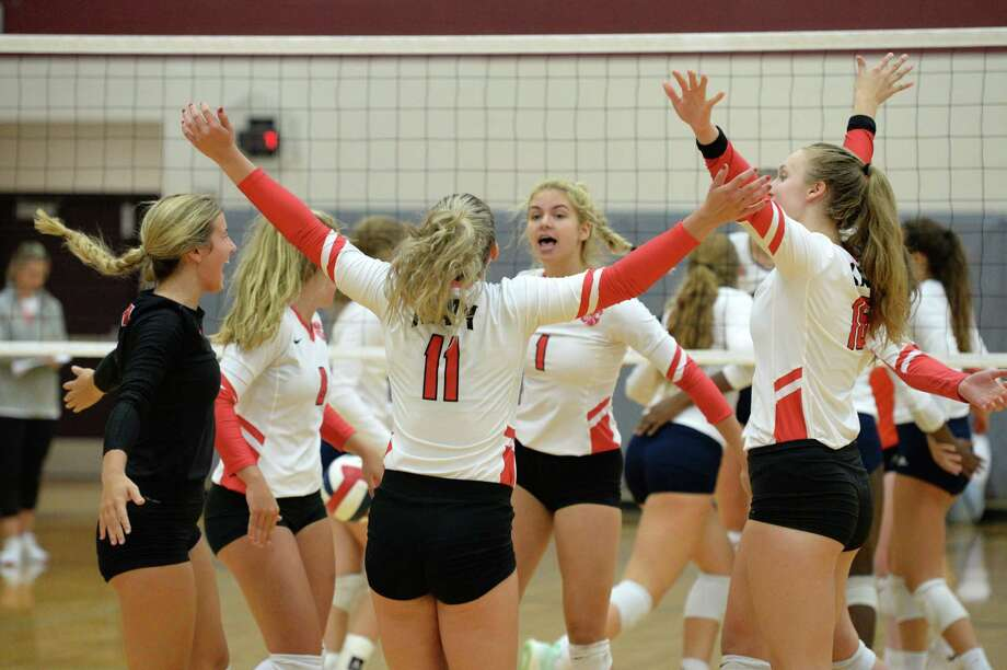 The Katy Tigers celebrate a point during the first set of a volleyball match against the Seven Lakes Spartans on Friday, August 9, 2019 at Cinco Ranch HS, Katy, TX. Photo: Craig Moseley, Staff / Staff Photographer / ©2019 Houston Chronicle