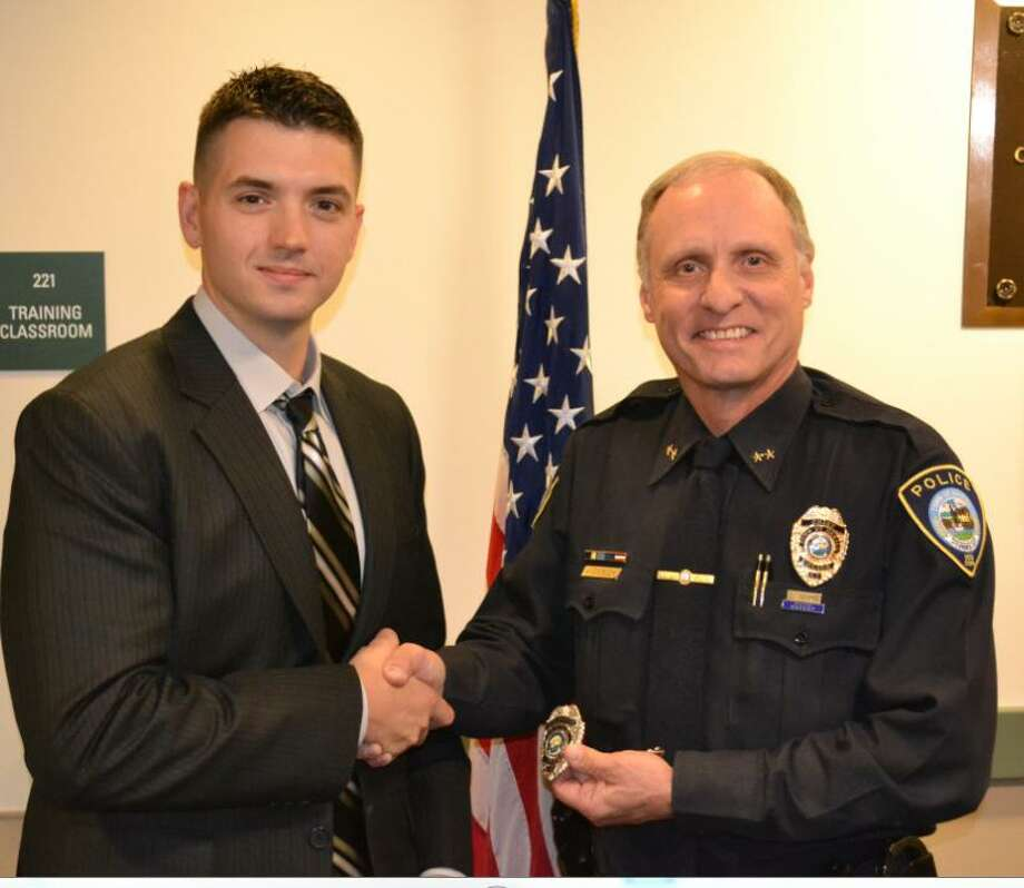 Shelton resident and Stratford police officer Matthew Ackerman, here with Chief Donald Anderson, is Darien's newest police officer. Photo: Darien Police