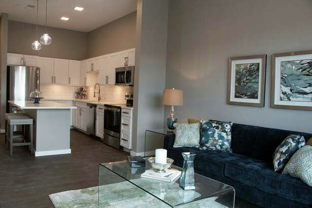 Some rooms will offer white cabinets with dark hardwood flooring and modern gray walls. The project includes multiple amenities such as a resort style pool, social lounge, a dog park, as well as convenient connections to the Madison County trail system.