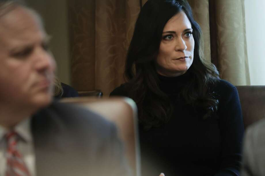 White House press secretary Stephanie Grisham listening to President Donald Trump during a Cabinet meeting in the Cabinet Room of the White House, Monday, Oct. 21, 2019, in Washington. (AP Photo/Pablo Martinez Monsivais) Photo: Pablo Martinez Monsivais, Associated Press