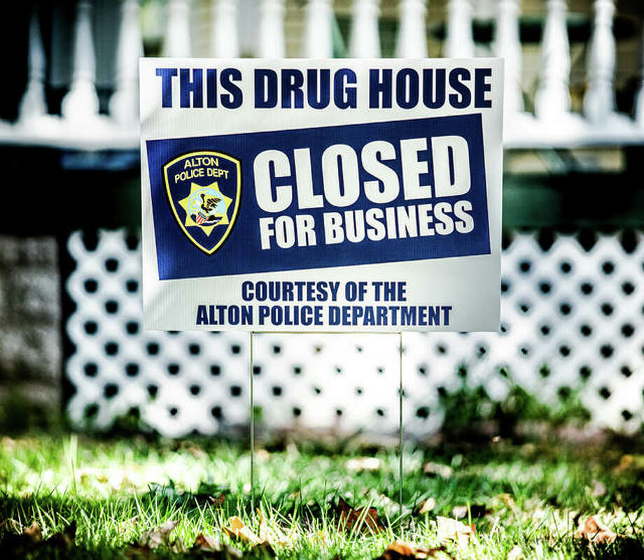 "A sign that reads ""This drug house closed courtesy of The Alton Police Department"" on display. Photo: Nathan Woodside 