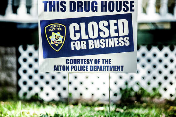"A sign that reads ""This drug house closed courtesy of The Alton Police Department"" on display."