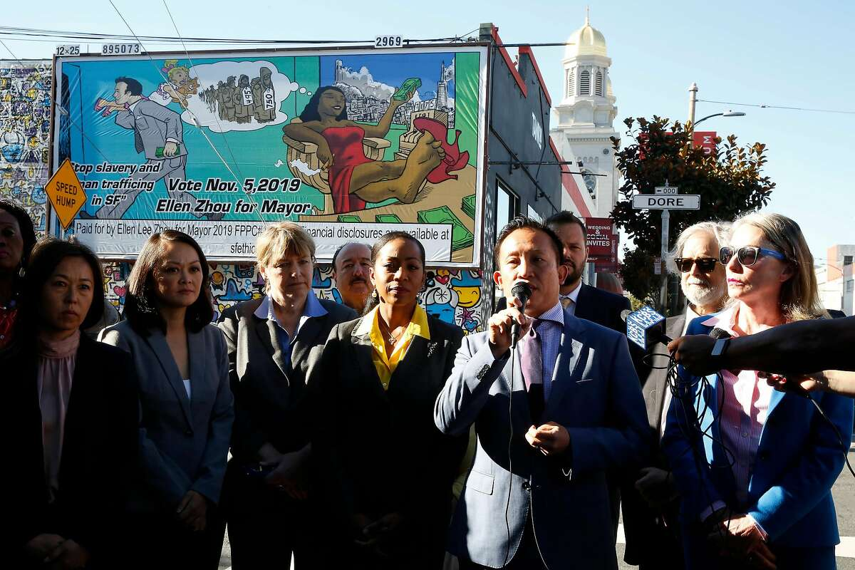 Assembly member David Chiu (front row second from right) stands with other San Francisco officials as he speaks during a press conference in which San Francisco leaders protested the Ellen Zhou for Mayor billboard that they say is racist on Monday, October 21, 2019 in San Francisco, Calif.