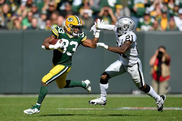GREEN BAY, WISCONSIN - OCTOBER 20: Aaron Jones #33 of the Green Bay Packers runs with the football in the first quarter against Gareon Conley #21 of the Oakland Raiders at Lambeau Field on October 20, 2019 in Green Bay, Wisconsin. (Photo by Quinn Harris/Getty Images)