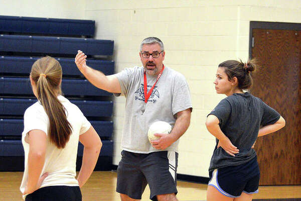 Father McGivney girls volleyball coach Paul Vieth talks to his players during practice last week.