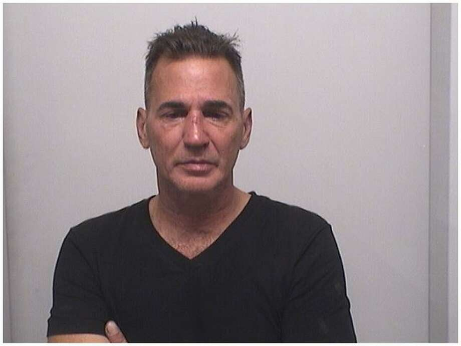 Todd Palumbo, 51, of Stamford was charged with a hate crime for beating up his girlfriend because she was talking to two black men in Latham Park, police say. Photo: Stamford Police Department / Contributed