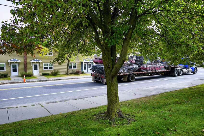 A tractor trailer is driven along South Pearl St. past the Ezra Prentiss Homes on Monday, Oct. 21, 2019, in Albany, N.Y. The DEC held the press event at the homes on Monday to announce the results of an air quality study in and around the Ezra Prentiss Homes. The study showed that traffic-related air pollution is a problem in the area. (Paul Buckowski/Times Union)