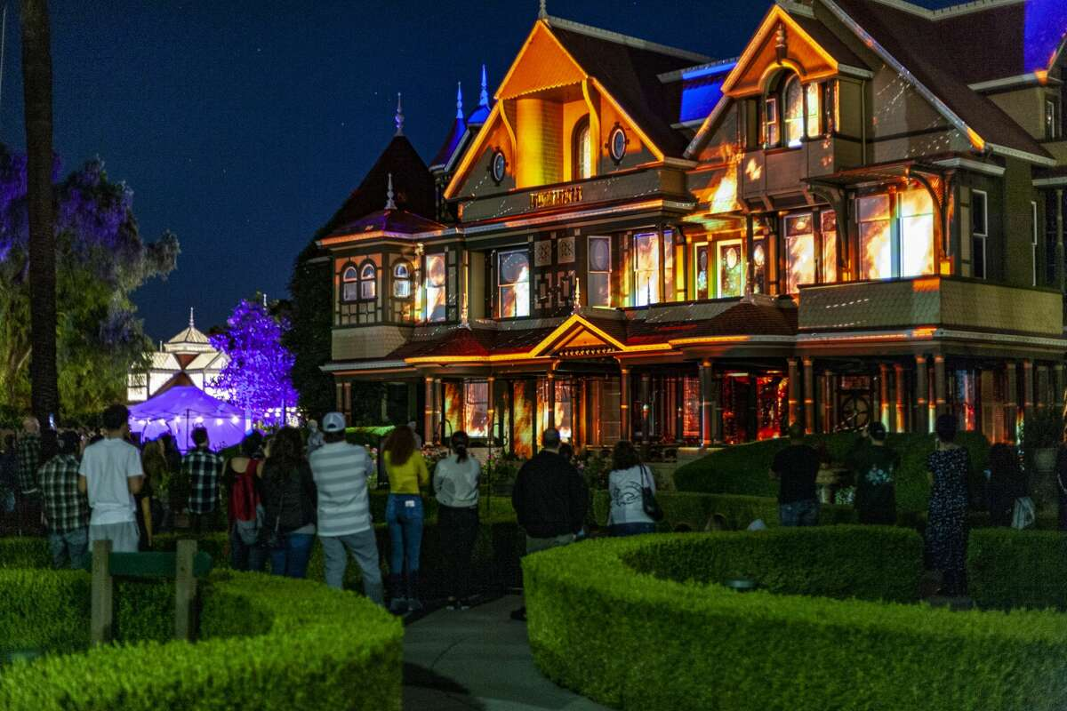 """""""Unhinged"""" at the Winchester Mystery House includes a light show projected onto the home's front every half hour. Multiple employees implored us to stay and see it. It was, indeed, cool."""