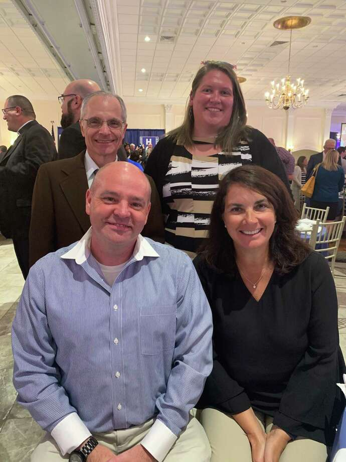 Michael Delaney and Diane Piechota with Principal Frank Lacerenza and Assistant Principal Liz Plasky. Photo: Contributed Photo.