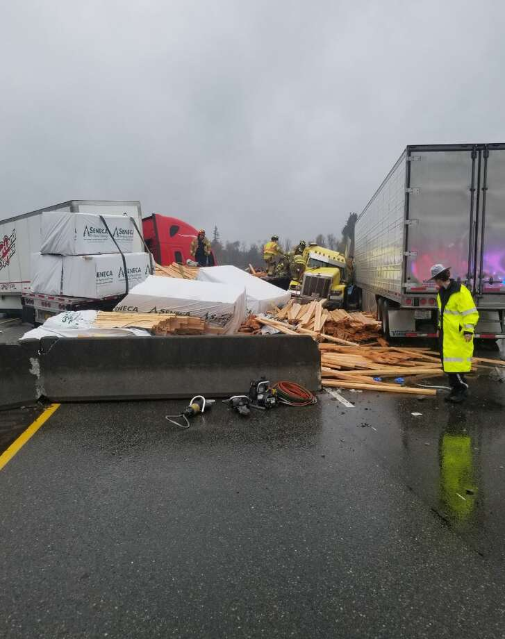 A crash on Interstate 5 south of Olympia spread debris over the freeway, causing a complete shutdown in both directions. Photo: Courtesy WSP