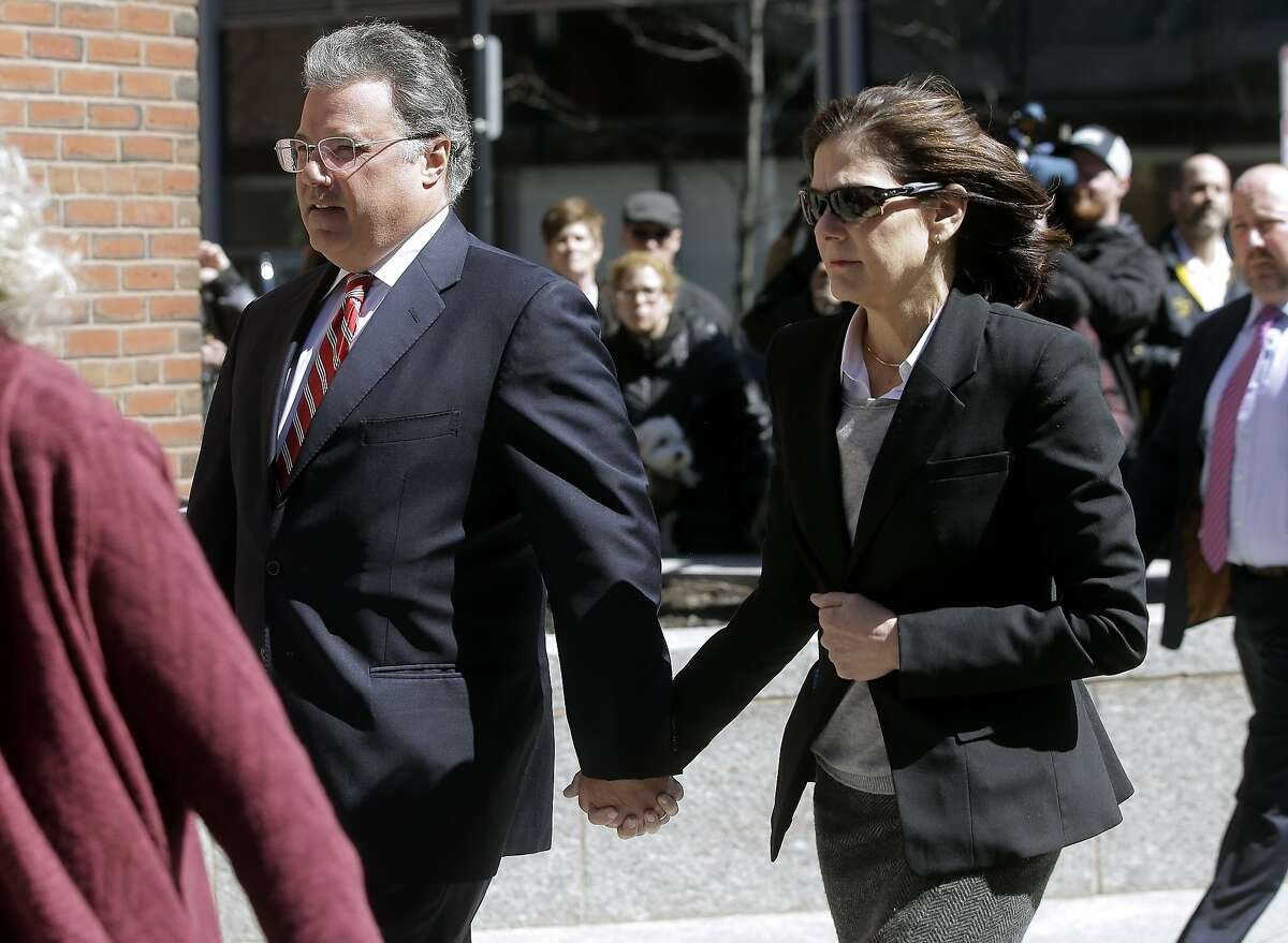FILE - In this April 3, 2019, file photo, Manuel and Elizabeth Henriquez arrive at federal court in Boston to face charges in a nationwide college admissions bribery scandal. The couple are scheduled to plead guilty on Monday, Oct. 21. (AP Photo/Steven Senne, File)
