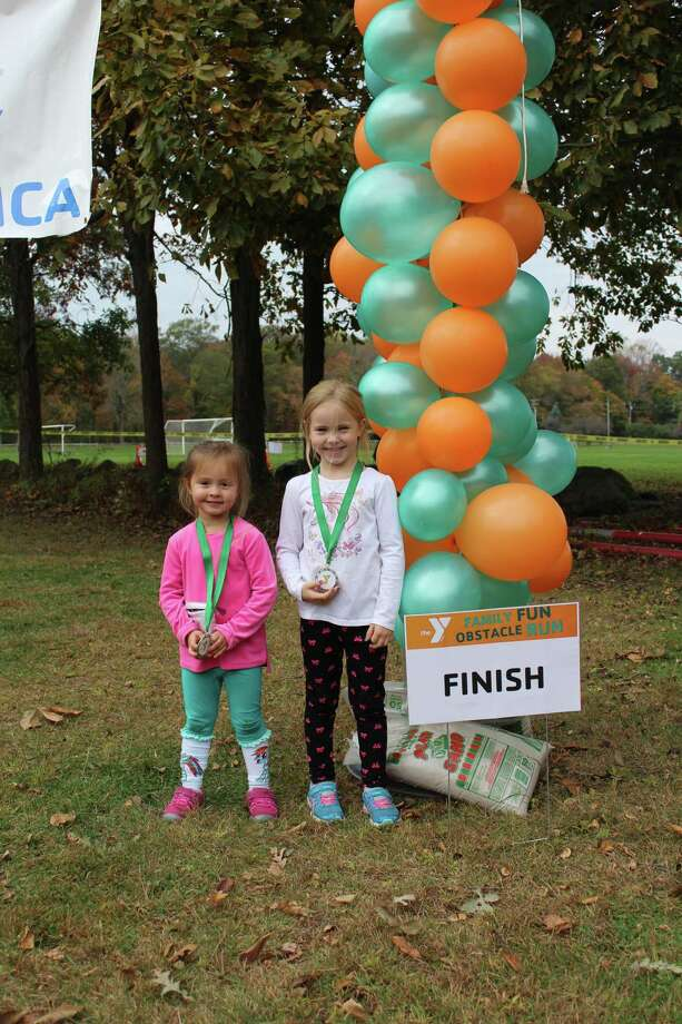 Cassidy and Callyn Stanley at the finish line. New Canaan YMCA / Contributed photo Photo: New Canaan YMCA / Contributed Photo