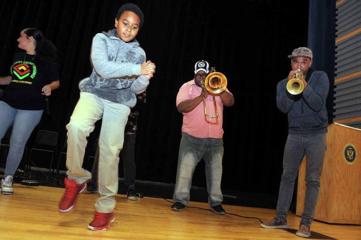 Sousaphonist Ben Jaffe and saxophonist Clint Maedgen of the Preservation Hall Jazz Band perform at Harding High School, in Bridgeport, Conn. Oct. 21, 2019.