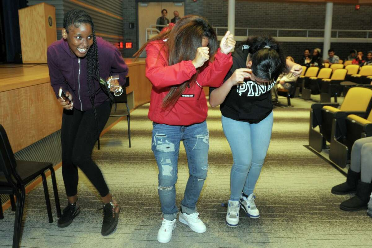 Above, students dance along to the music of the Preservation Hall Jazz Band as they perform at Harding High School, in Bridgeport on Monday.