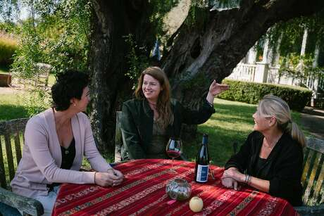 (Left to right) Blue Farm estate director, Jessica Case, Amy Bess Cook, owner of Woman-Owned Wineries, and Vineyard owner Anne Moller-Racke, sit for a photo at Blue Farm Vineyards in Sonoma, Calif. on Monday, Oct. 14, 2019.