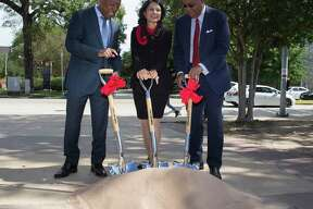 Houston Mayor Sylvester Turner, from left, University of Houston System Chancellor Renu Khator and Harris County Precinct One Commissioner Rodney Ellis perform a ground breaking ceremony during a press conference on Cullen Boulevard on Monday, Oct. 21, 2019, in Houston. The Cullen Boulevard Construction Project is a joint project between the city, county and the university. The project will improve safety, mobility and drainage along the university corridor around UH and Texas Southern University.
