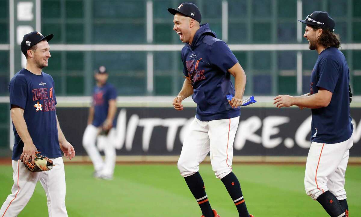 Houston Astros third baseman Alex Bregman, shortstop Carlos Correa and outfielder Jake Marisnick, far right, joke around during a workout as they get ready for for Game 1 of the World Series against the Washington Nationals at Minute Maid Park on Monday, Oct. 21, 2019, in Houston.