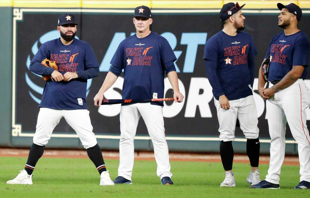 Houston Astros pitcher Jose Urquidy, left, stands with manager AJ Hinch, and relief pitchers Roberto Osuna, and Josh James in the outfield during a workout before Game 1 of the World Series against the Washington Nationals at Minute Maid Park on Monday, Oct. 21, 2019, in Houston.